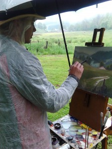 Jeremy plein air painting in the rain