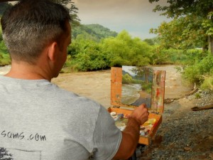 Jeremy plein air painting on the banks of the New River in Todd, NC