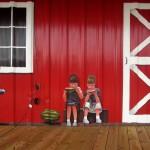 Lenoir County Farmer's Market mural, Kinston, NC. Detail of kids eating watermelon by North Carolina artist, Jeremy Sams.